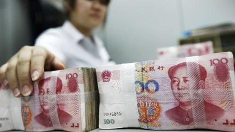 La mordida del Tigre al Búfalo:  El yuan chino le está ganando la partida al dólar norteamericano. Foto: AFP.